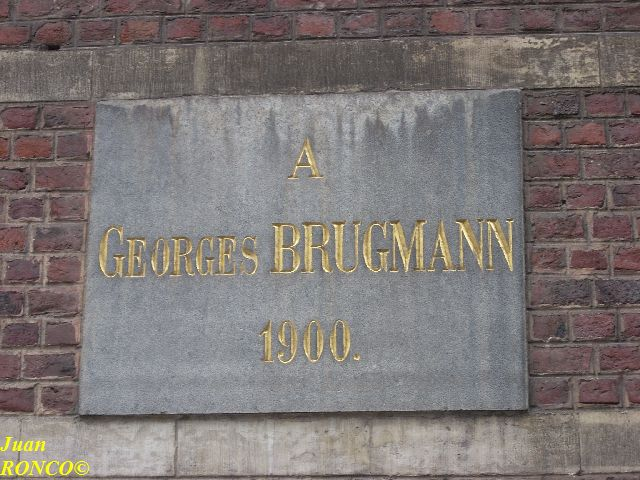 Plate with the name of a benefactor in the façade of the Dutch speaking Jesuits' school of Brussels